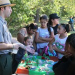 U.S. Army Corps of Engineers park ranger Gary Basile teaches a group of students from Maple Elementary School about the wetlands.