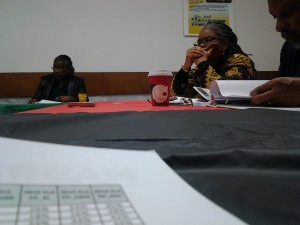 Focused Members of the Black Parallel School Board discussing issues