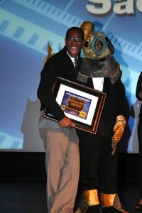 """Dwight Taylor, writer of A Place Called Sacramento film """"Tailypo""""  feels right at home on stage with festival mascot Quentin Sacramento."""