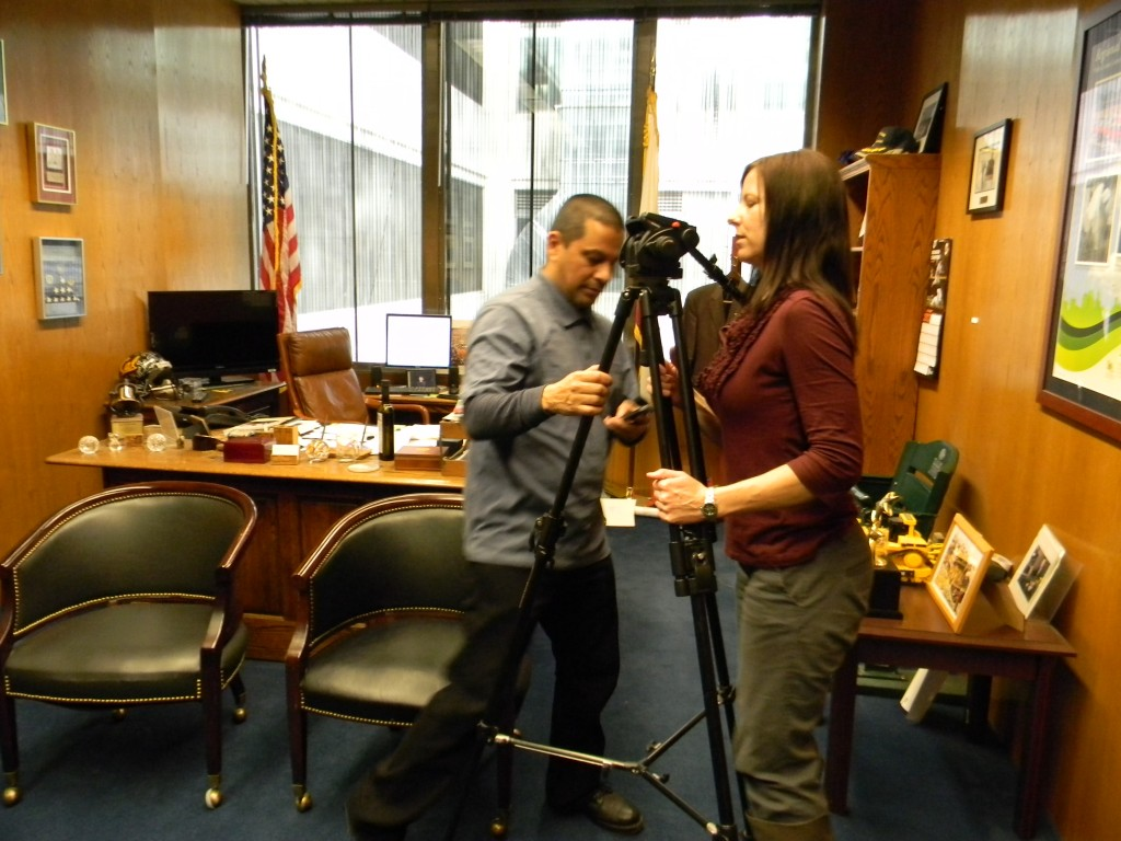 Access Sacramento crew setting up cameras and audio for an interview.