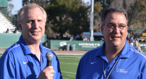 Announcer Scott Marsh (left) interviews Gary Martin during the live TV broadcast of Guns & Hoses charity football Jan. 25 at Sac State's Hornet Field.