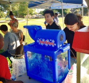 Free sno-kones and popcorn attracted many young participants.