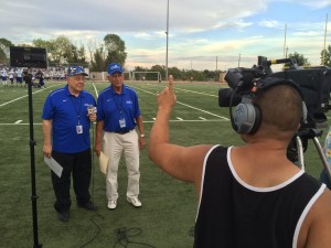 Will James (from left) and Jim Dimino on the sidelines during rehearsal with Cameraman Adrian Gonzalez.