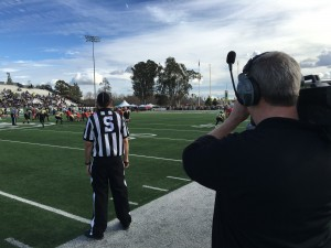 Camera operator Kevin Knight on the sidelines of the Pig Bowl 2016.