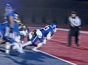Folsom running back Brandon Rupchock crossing the goal line on a four-yard TD run.