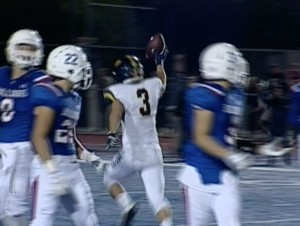 Oak Ridge's Davis Lang recovers an on-side kick giving the Trojan's one more chance with :47 in the game.